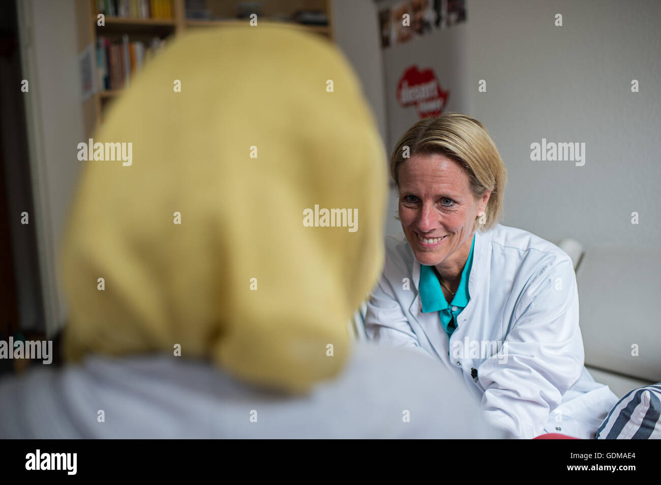 Berlin, Germany. 18th July, 2016. Senior physician Cornelia Strunz speaks with a patient in her office in the Waldfriede - Stock Image