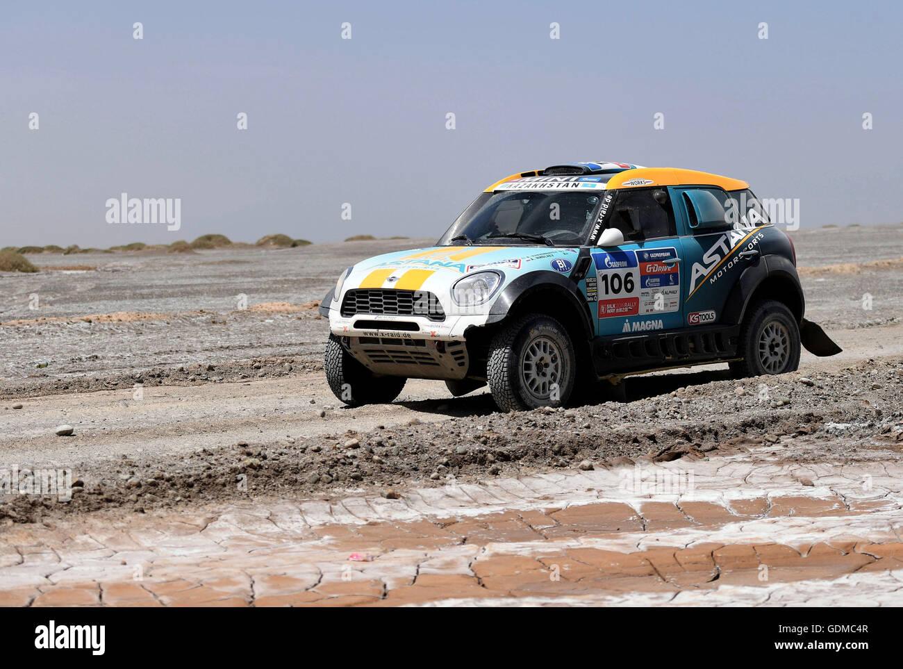 Dunhuang, China's Gansu Province. 19th July, 2016. ASTANA Motorsport's driver Aidyn Rakhimbayev and co-driver - Stock Image