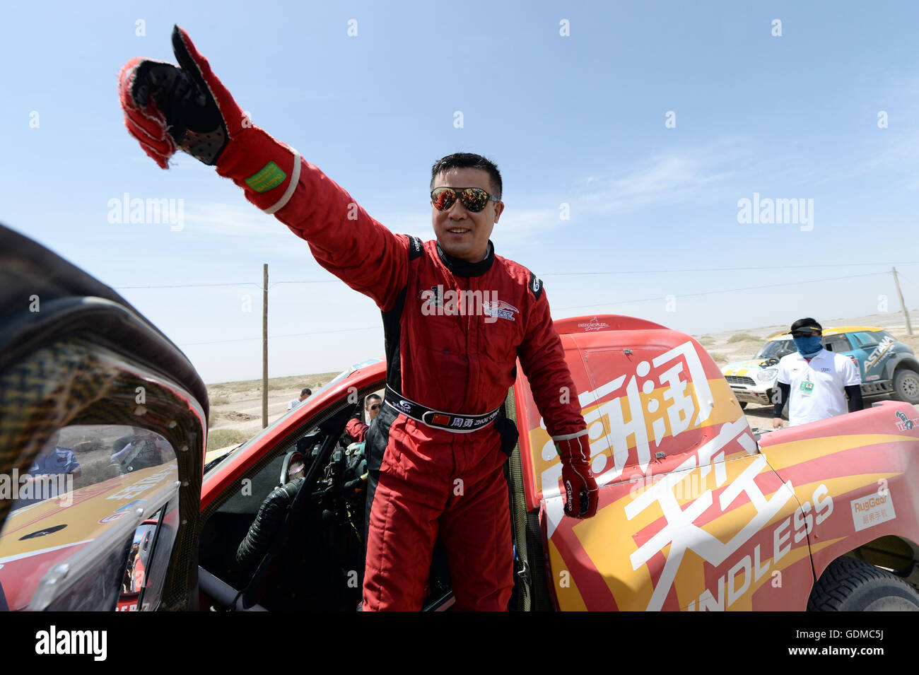 Dunhuang, China's Gansu Province. 19th July, 2016. Boundless Young Team driver Zhou Yong of China reacts after - Stock Image