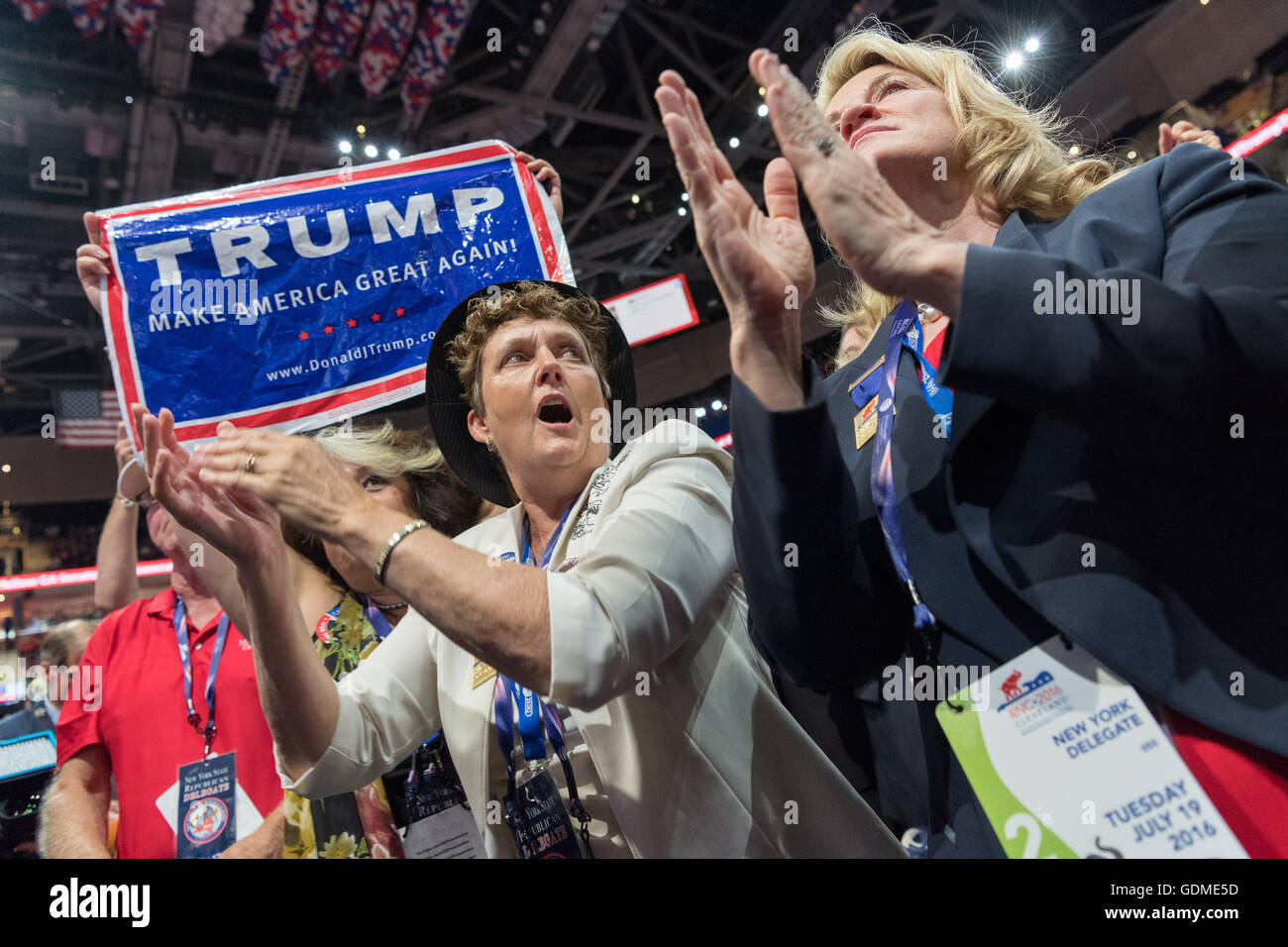Cleveland, Ohio, USA. 19th July, 2016. New York delegates celebrate the nomination of Donald Trump during the second Stock Photo