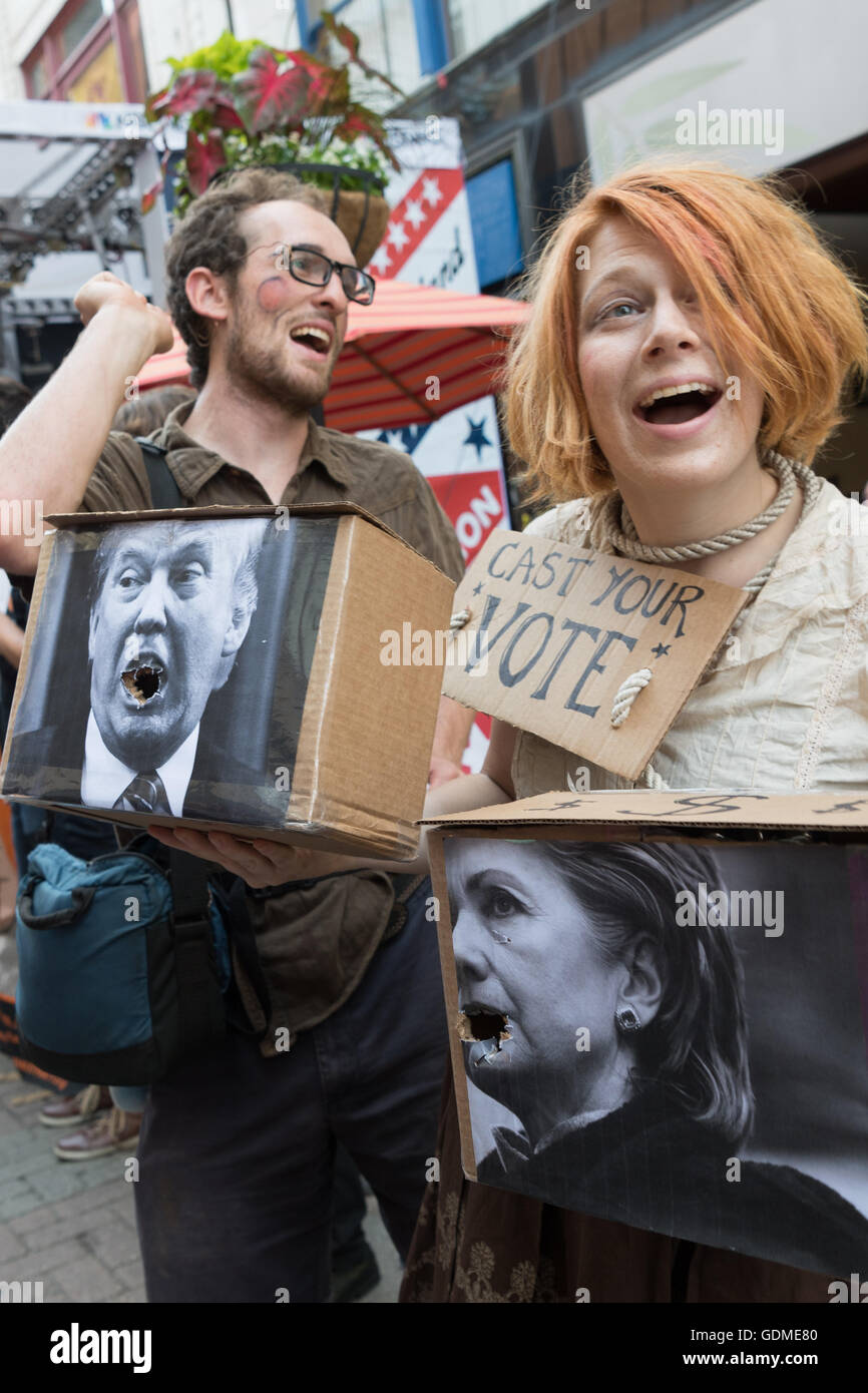 Protesters wearing Trump and Clinton ballot boxes as people are asked to make their choice outside the Quicken Loans - Stock Image