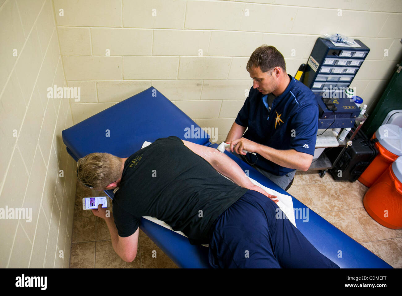 Daytona Beach, Florida, USA. 11th July, 2016. WILL VRAGOVIC | Times.Scott Thurston, right, Athletic Trainer for - Stock Image