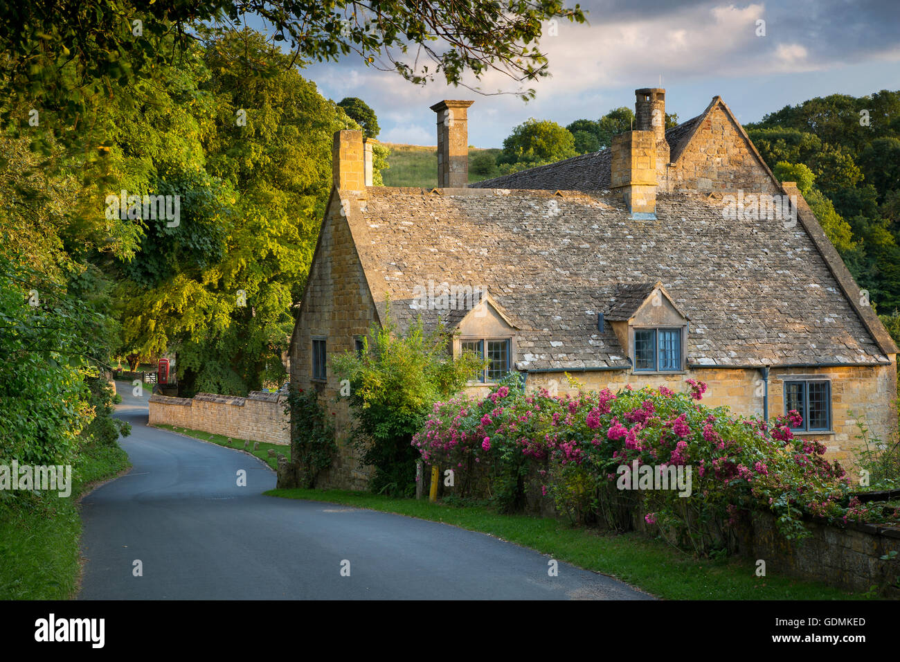Sunset over cottage in Snowshill, the Cotswolds, Gloucestershire, England - Stock Image
