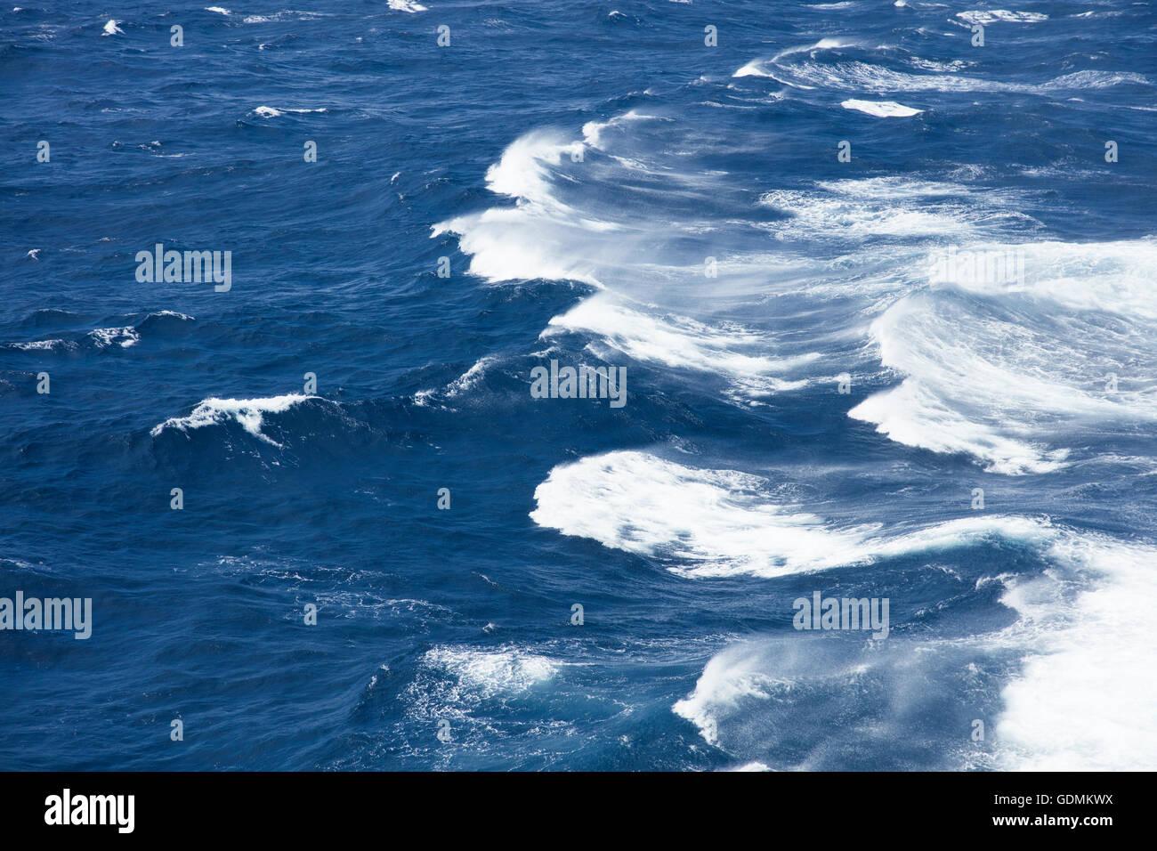 Sunshine on rough seas in the mid Atlantic Ocean Stock Photo
