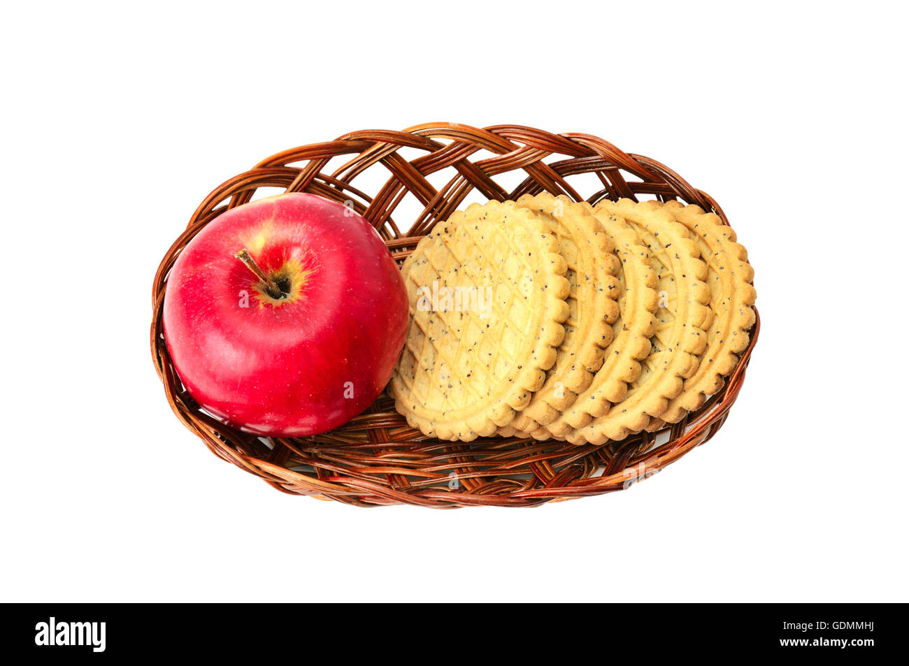 apple and biscuit in basket isolated on a white - Stock Image