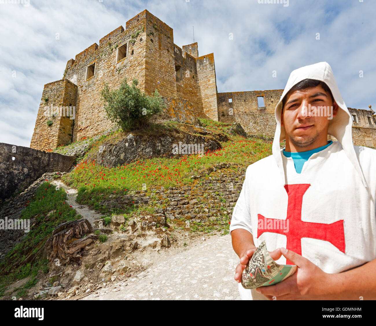 Brochure Distribution dressed as Templar front of castle, fortress of Tomar, the castle of the Knights Templar, - Stock Image