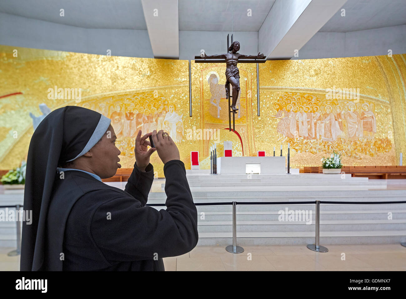 Nun photographed in the interior of the modern Church of the Trinity, opposite the Basilica, Igreja da Santissima - Stock Image