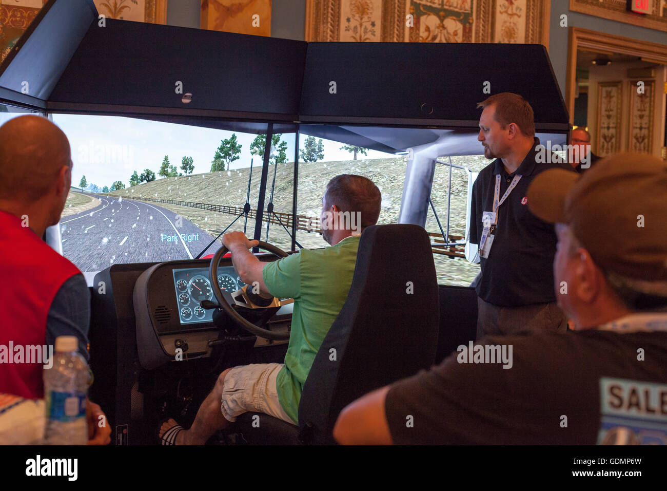 Las Vegas, Nevada - A delegate to the Teamsters Union convention drives a truck-driving simulator. - Stock Image