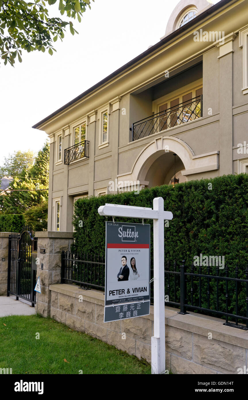 For sale sign outside a house in the upscale Shaughnessy district of Vancouver, British Columbia, Canada - Stock Image