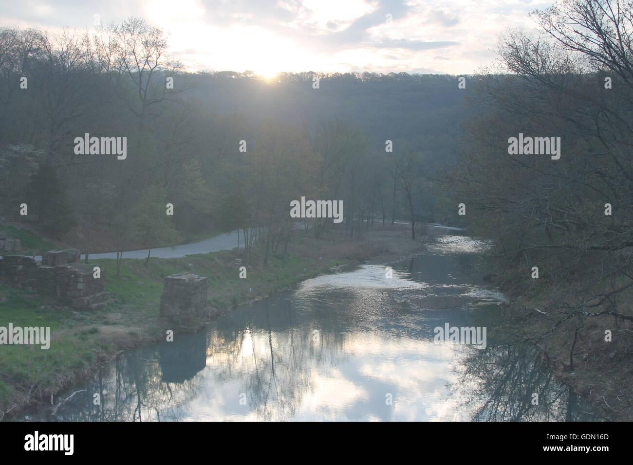 Sunrise over water at Devil's Den State Park in Arkansas - Stock Image