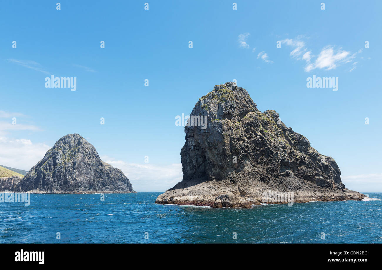 Majestic rocks in the famous Bay of Islands, New Zealand.Focus on the nearest rock - Stock Image