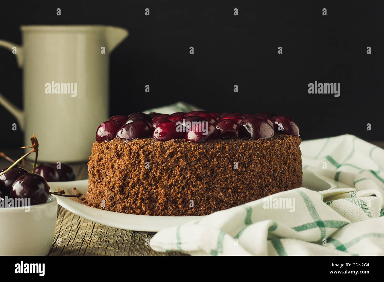 Chocolate cake with black cherry selective focus filtered - Stock Image