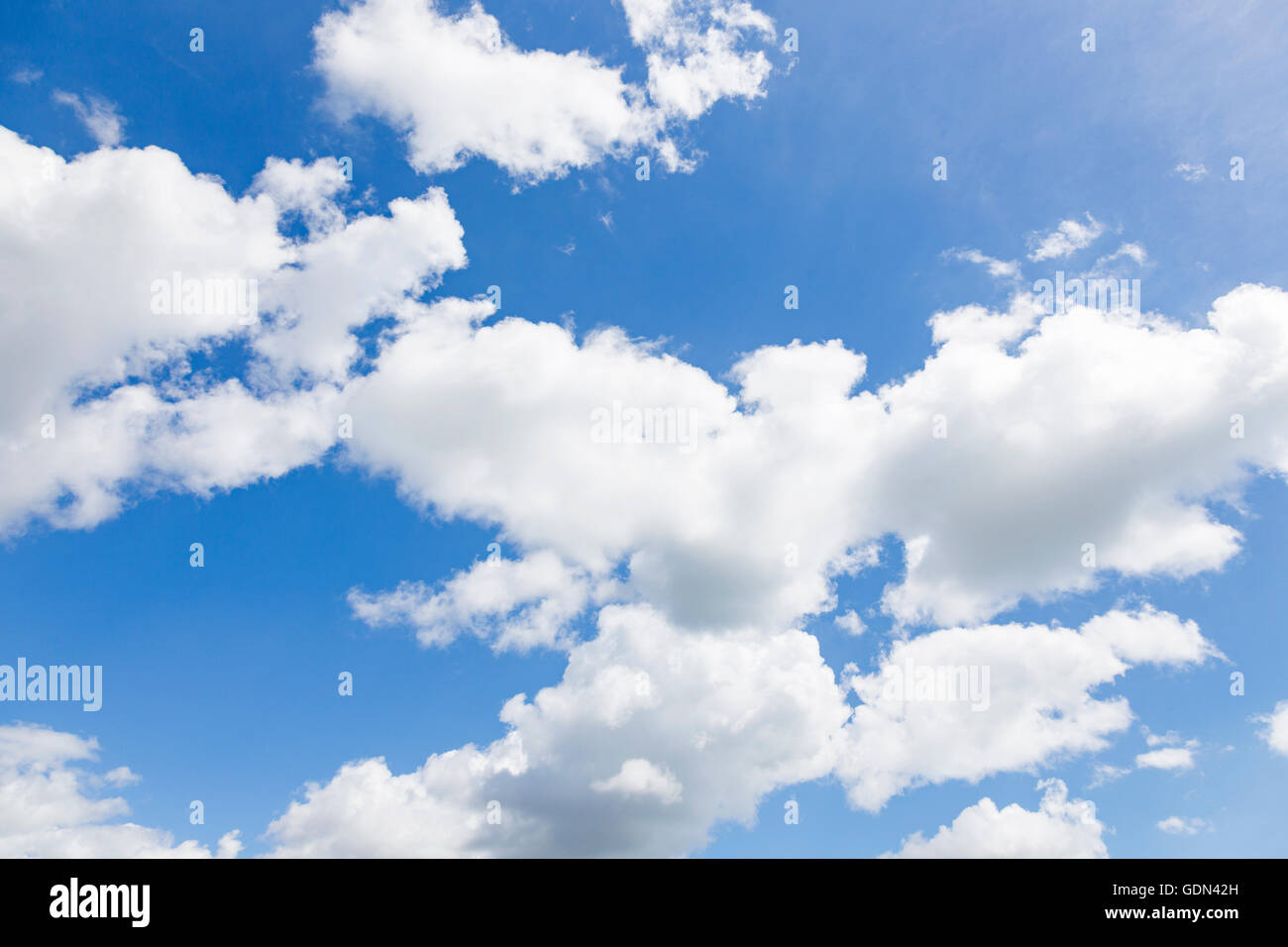 Cumulus clouds in blue sky, England - Stock Image