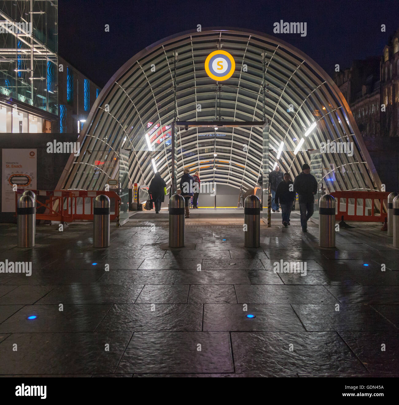 Passengers entering and exiting from St Enoch Subway station in central Glasgow. - Stock Image