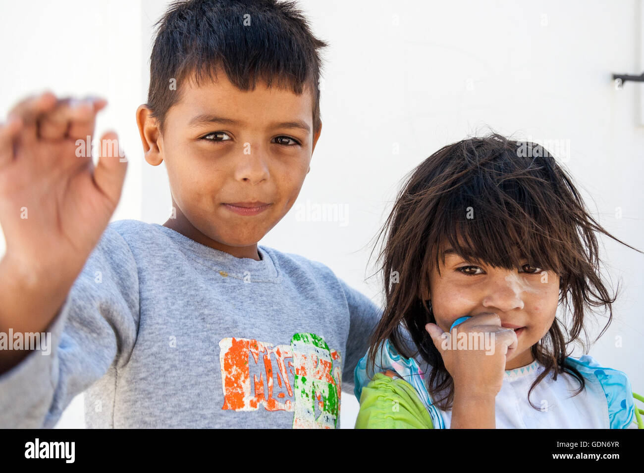 Greek islands, Santorini. Two children, brother and sister, boy and girl, 8-10 year old. Head & shoulders, looking - Stock Image