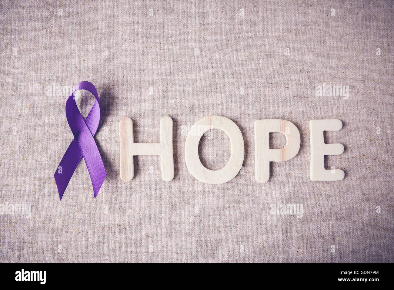 purple ribbon with hope wooden letter toning alzheimer s disease