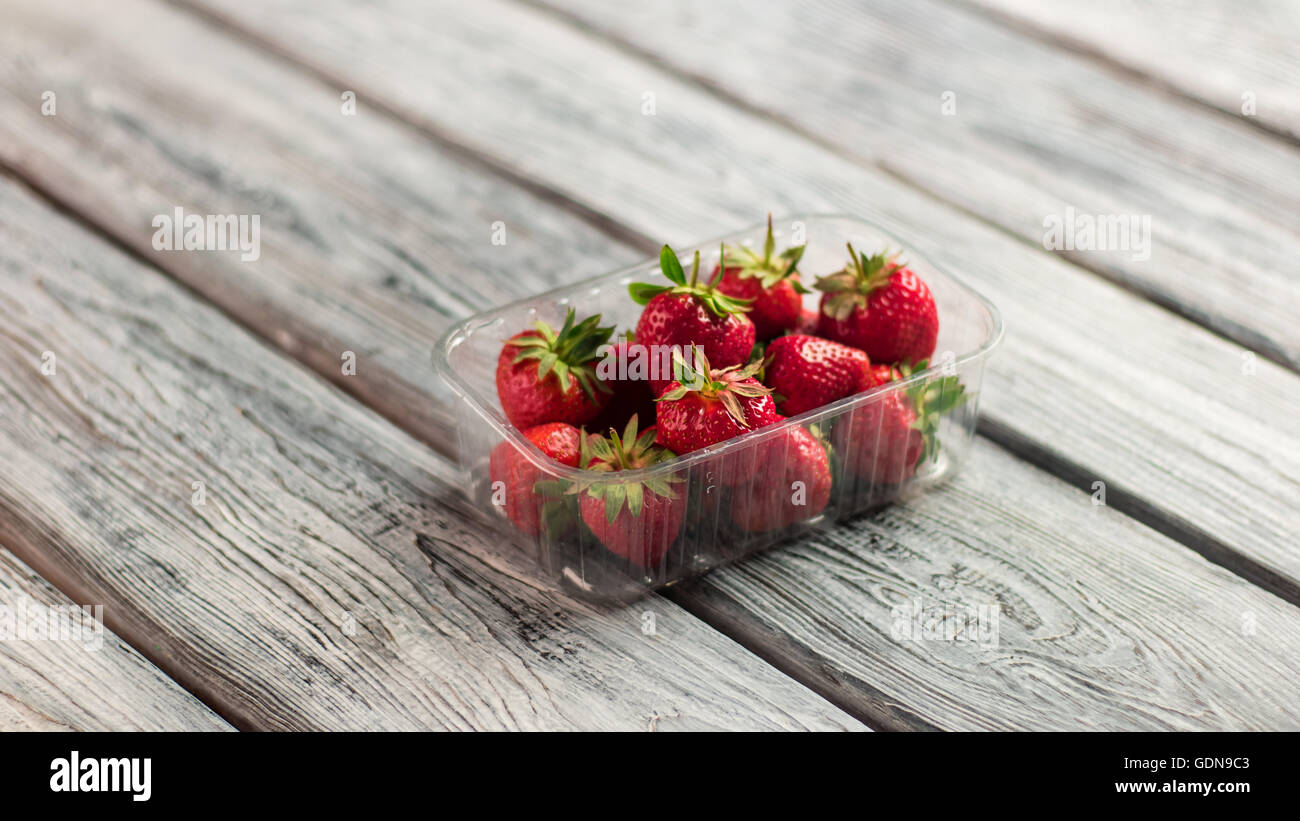 Strawberries in a container. - Stock Image