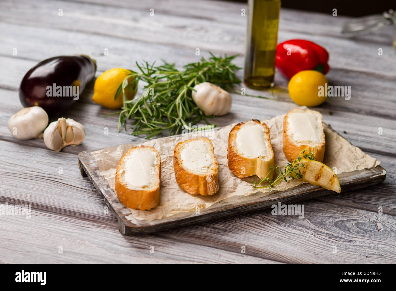 Baguette slices with butter. - Stock Image