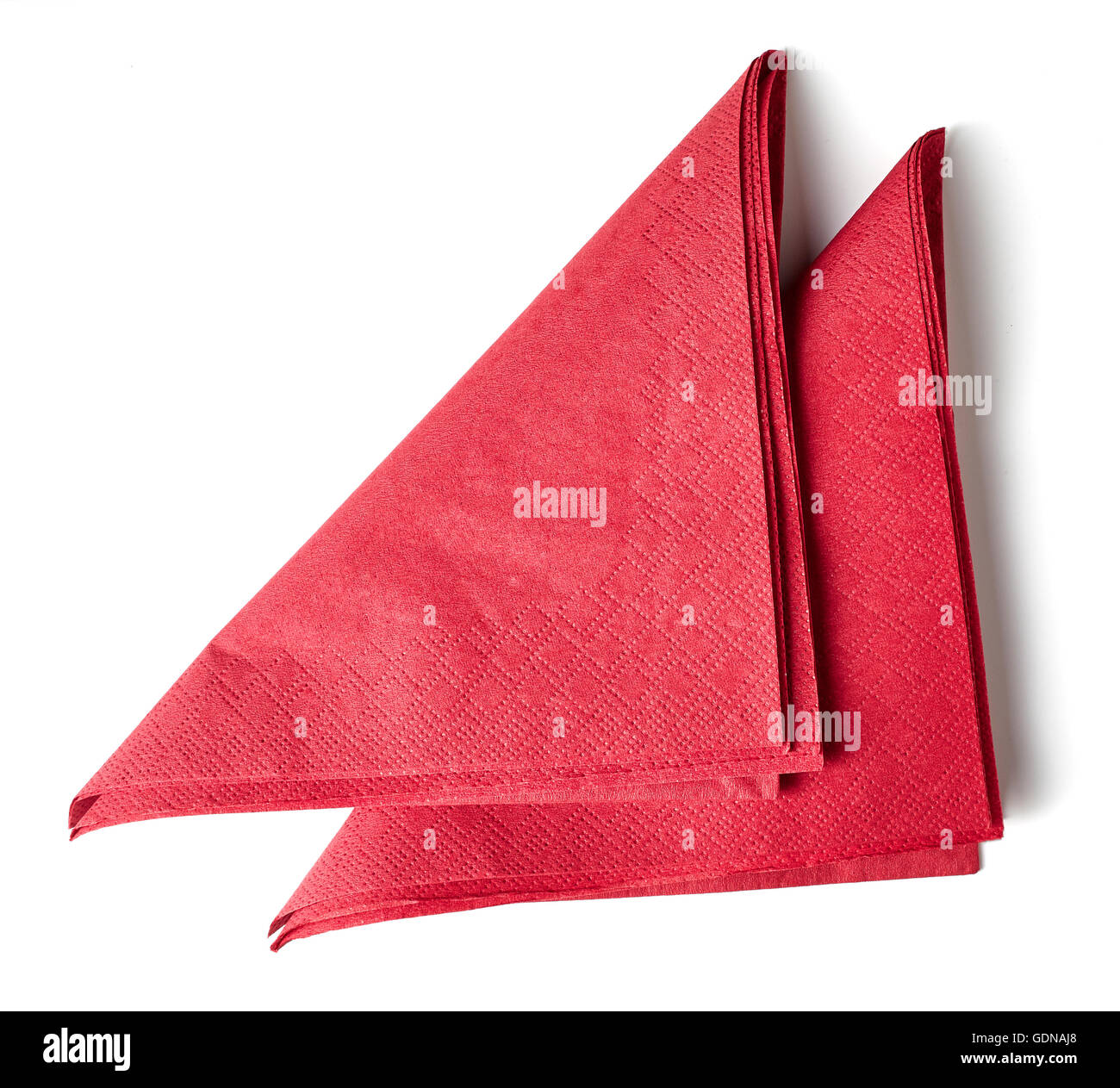 red paper napkins isolated on white background - Stock Image
