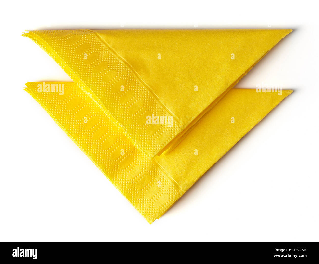 yellow paper napkins isolated on white background - Stock Image