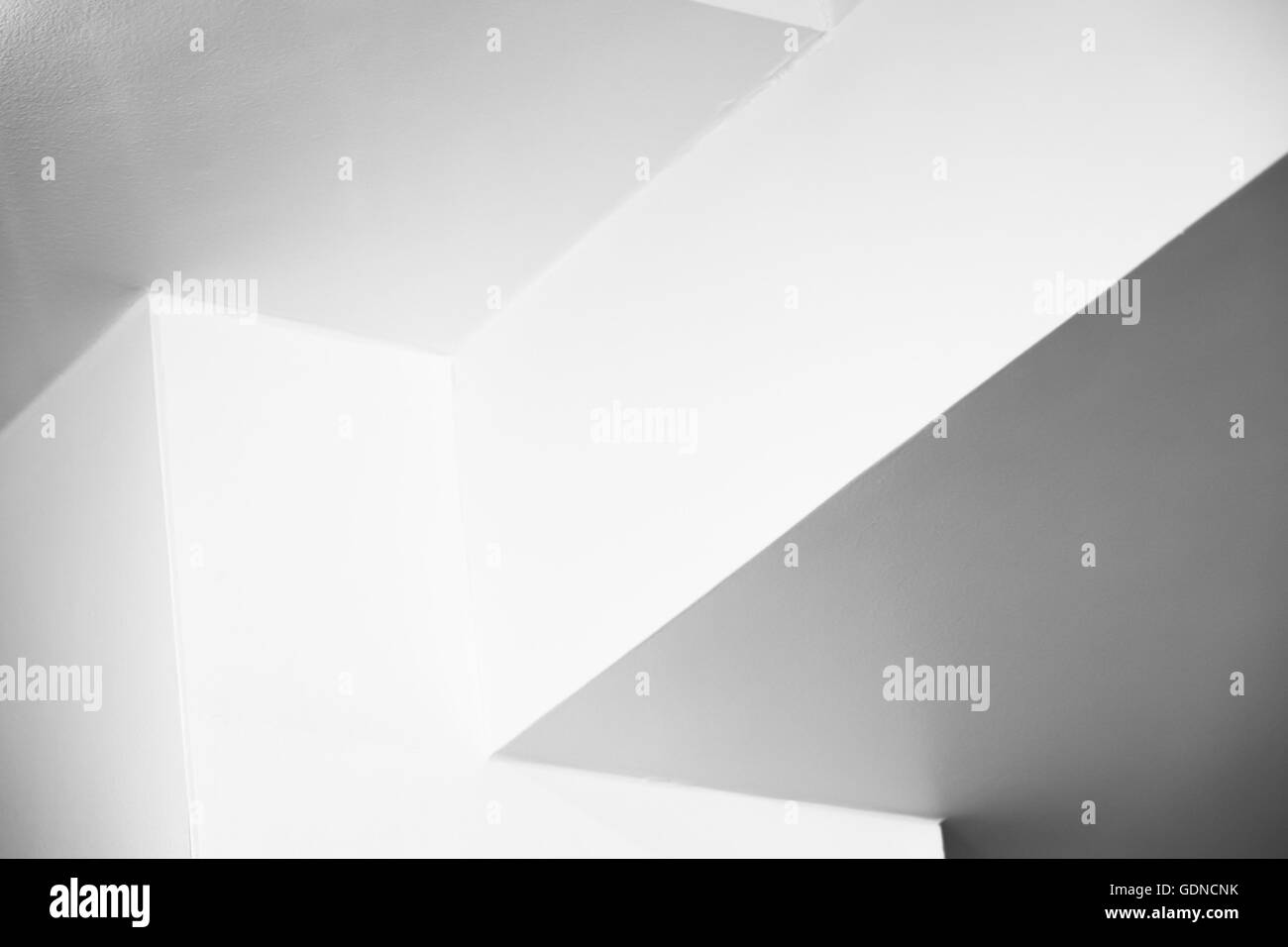 Abstract architecture background, empty white interior design with corners, black and white photo - Stock Image