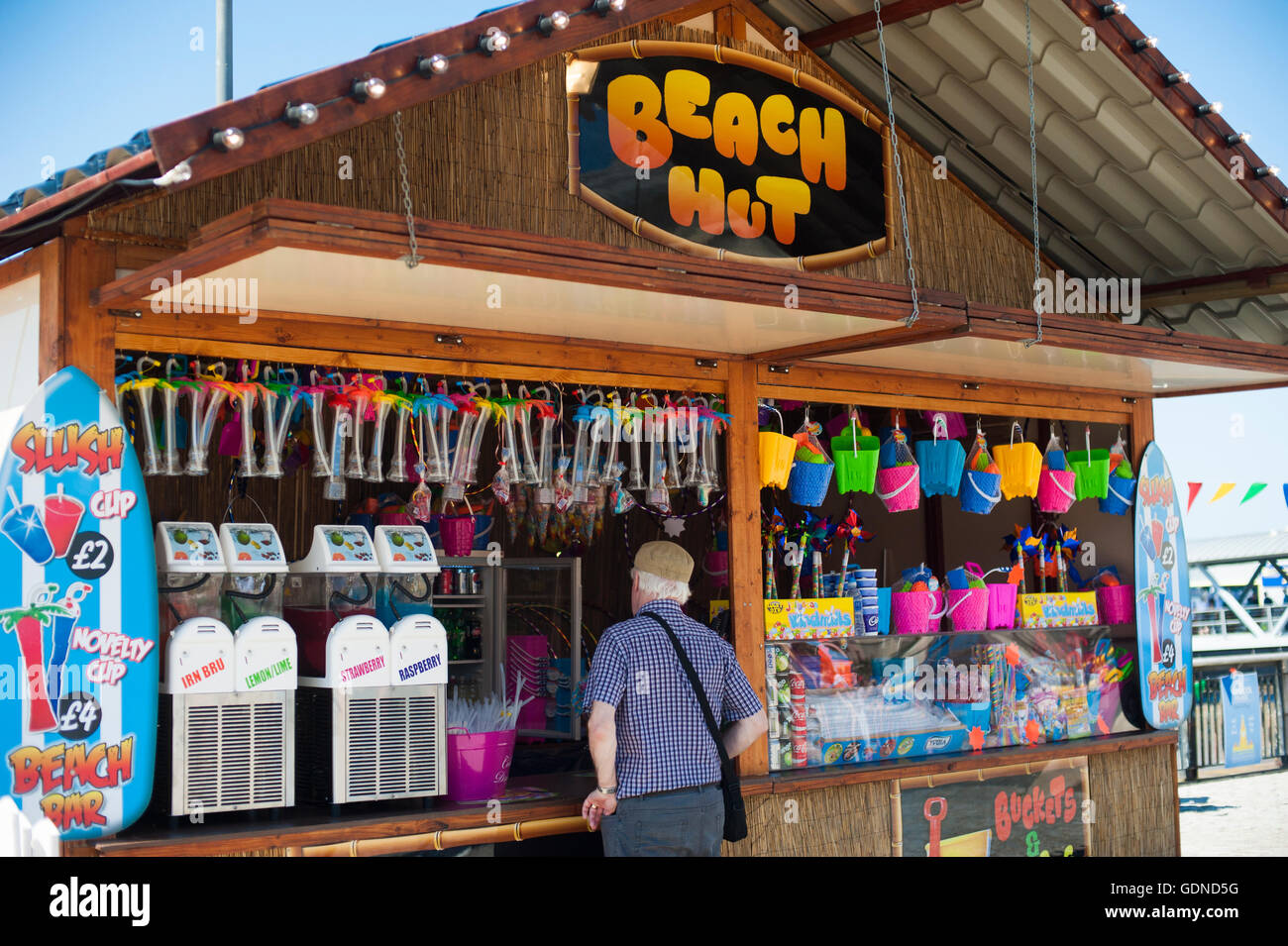 A temporary beach hut stall set up at the Liverpool pier head during summer heatwave 2016 uk Stock Photo