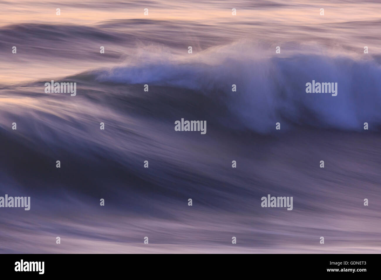 Pacific Ocean wave patterns after sunset, Pacific Beach, San Diego, CA, USA - Stock Image