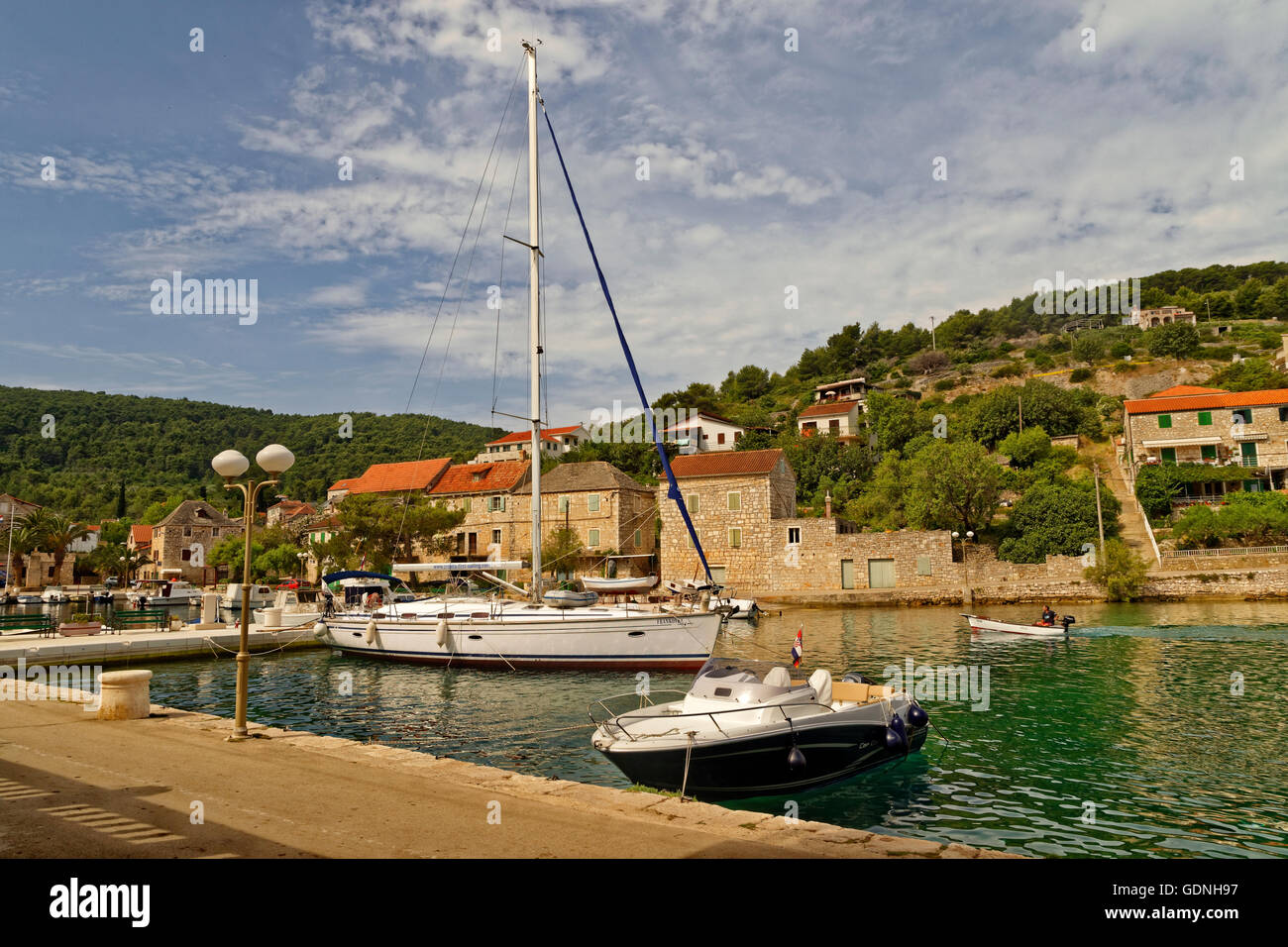 Cruising yacht berthed at the village quay of Stomorska on the island of Solta in Croatia. - Stock Image