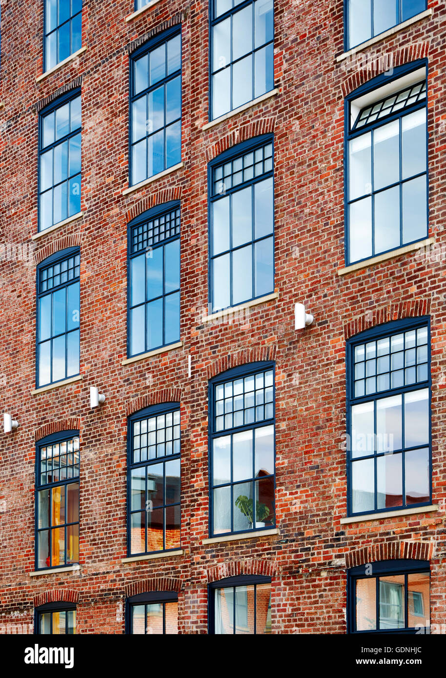 Windows and brickwork of Marshall Mills property redevelopment for mixed use and residential - Stock Image