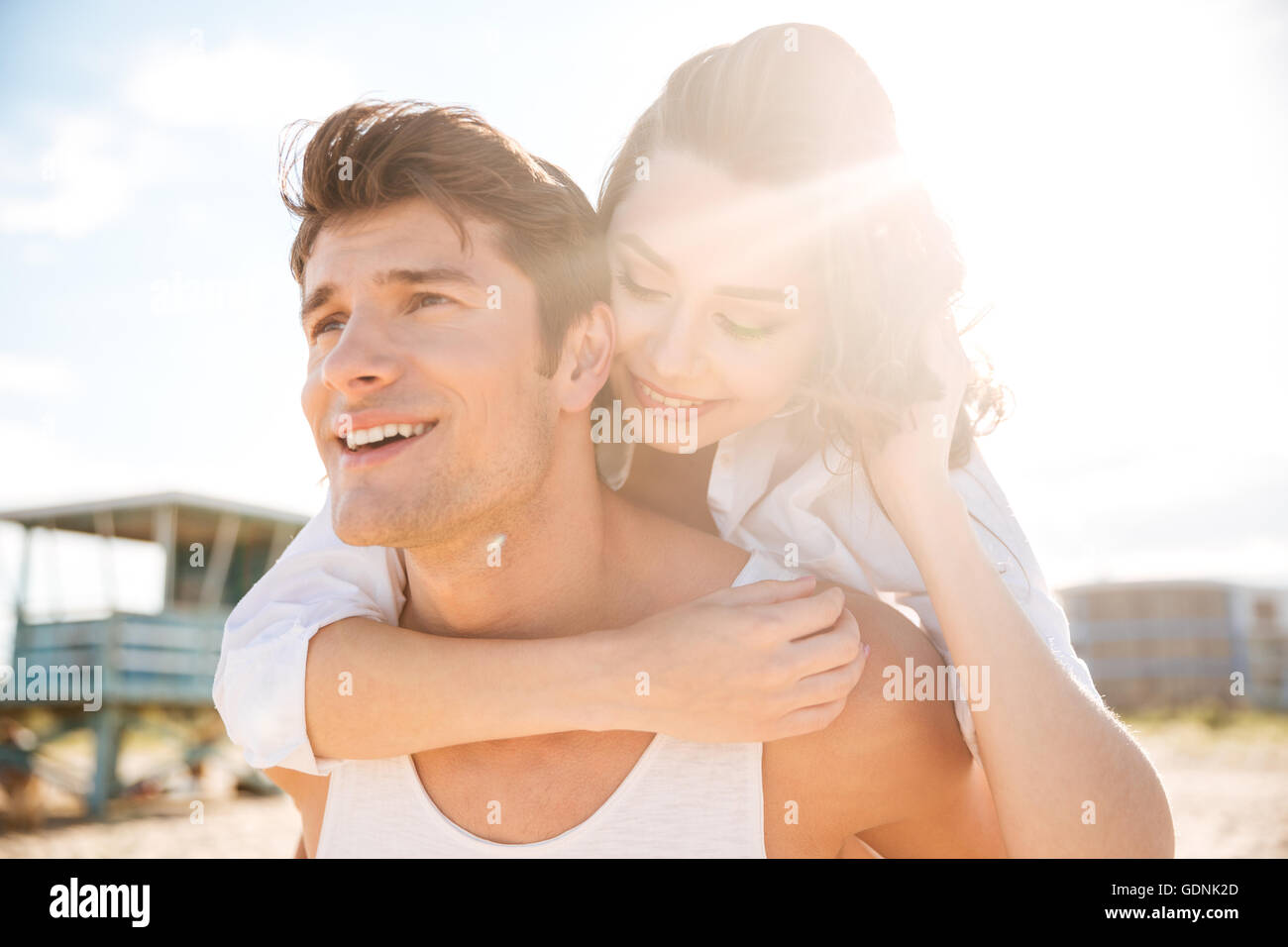 Closeup of happy young couple on the beach - Stock Image