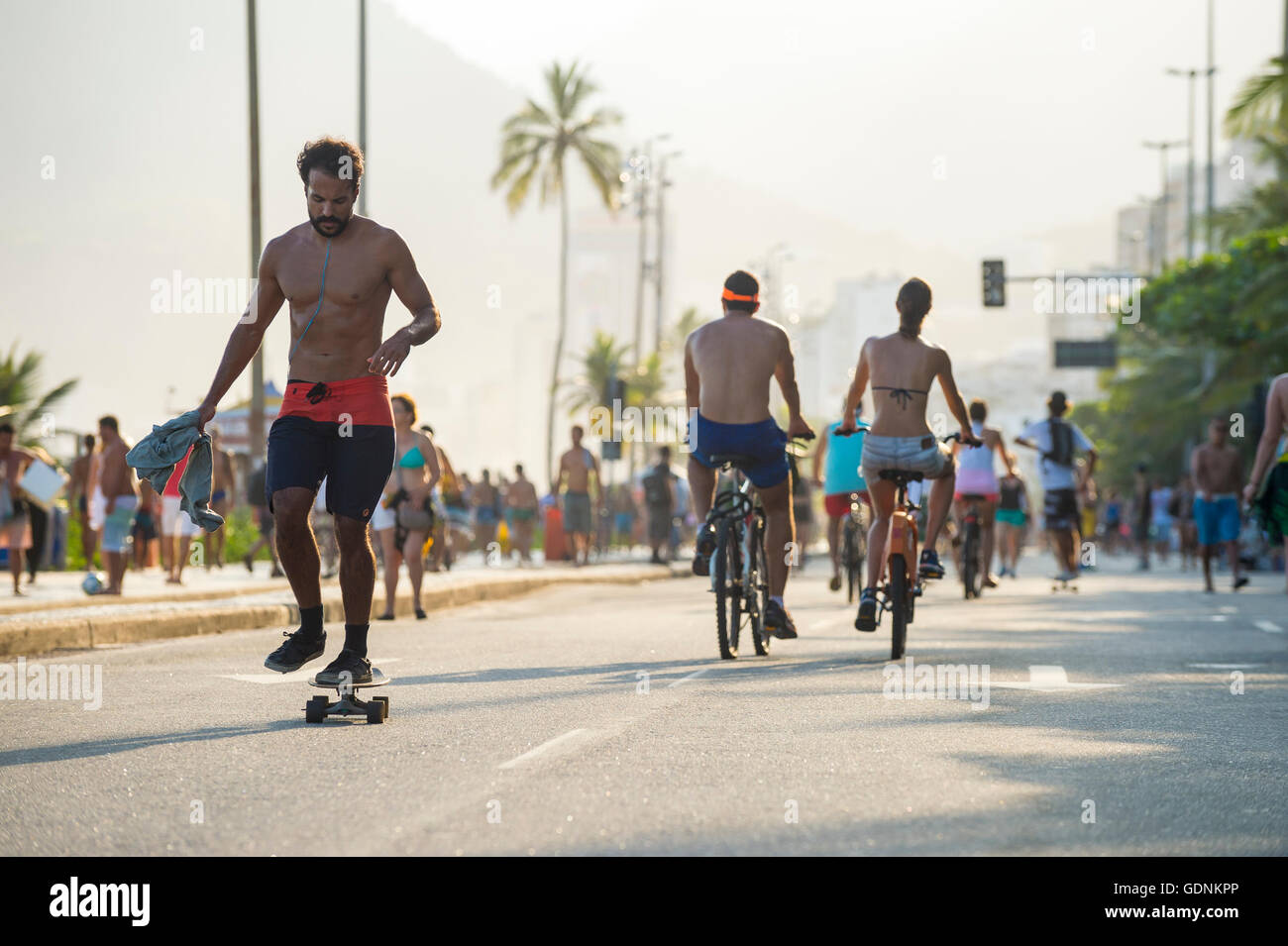 RIO DE JANEIRO - MARCH 6, 2016: Residents take advantage of a car-free Sunday afternoon on the beachfront Avenida - Stock Image