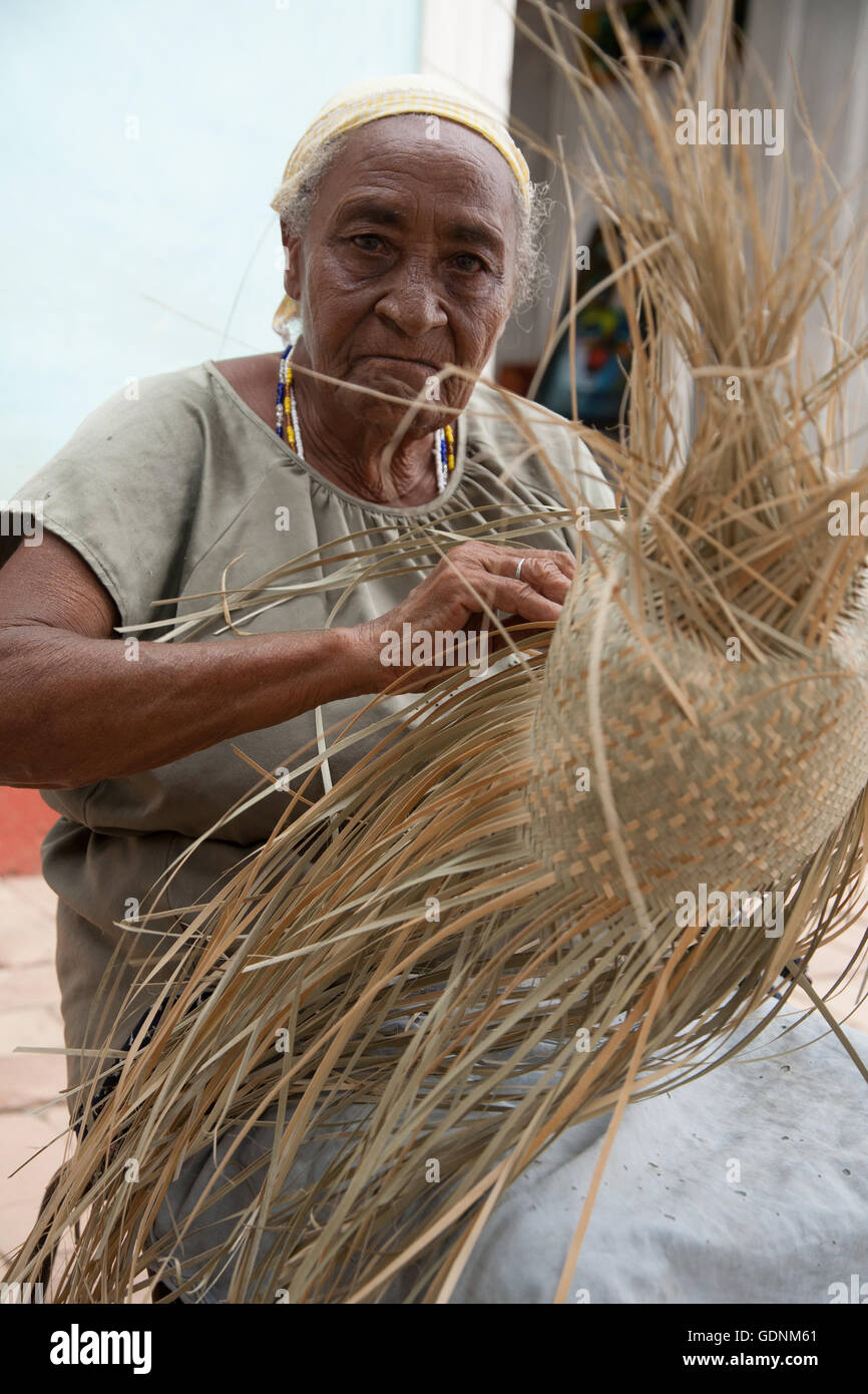 Woman making a sombrero hat in a craft market in Trinidad, Cuba Stock Photo