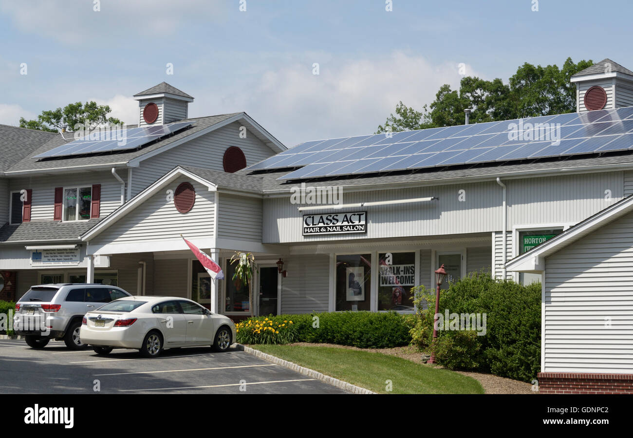 Solar panels on roof of a commercial shopping development - Stock Image