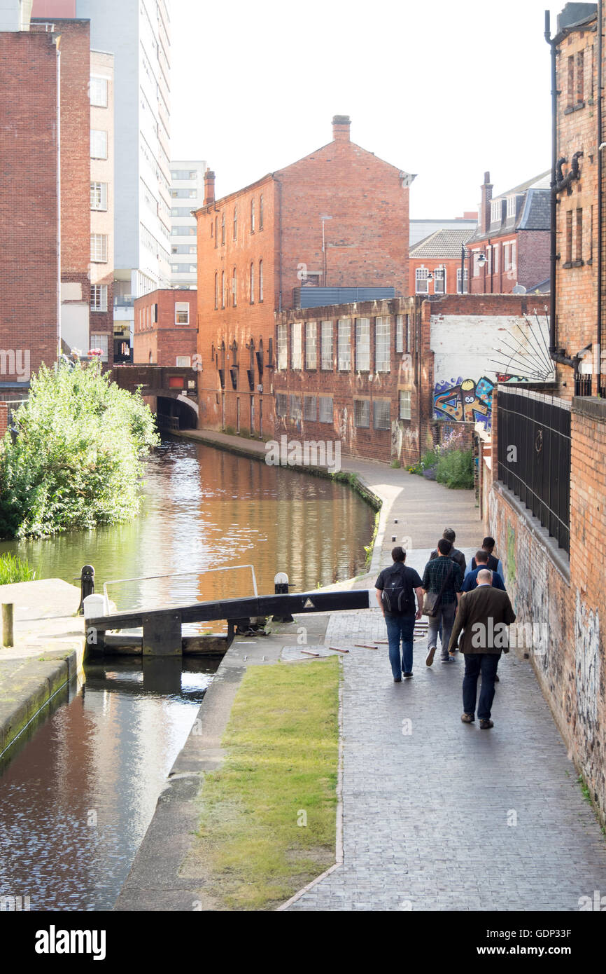 Men walking along a towpath beside a canal in the Jewellery Quarter, Birmingham. - Stock Image