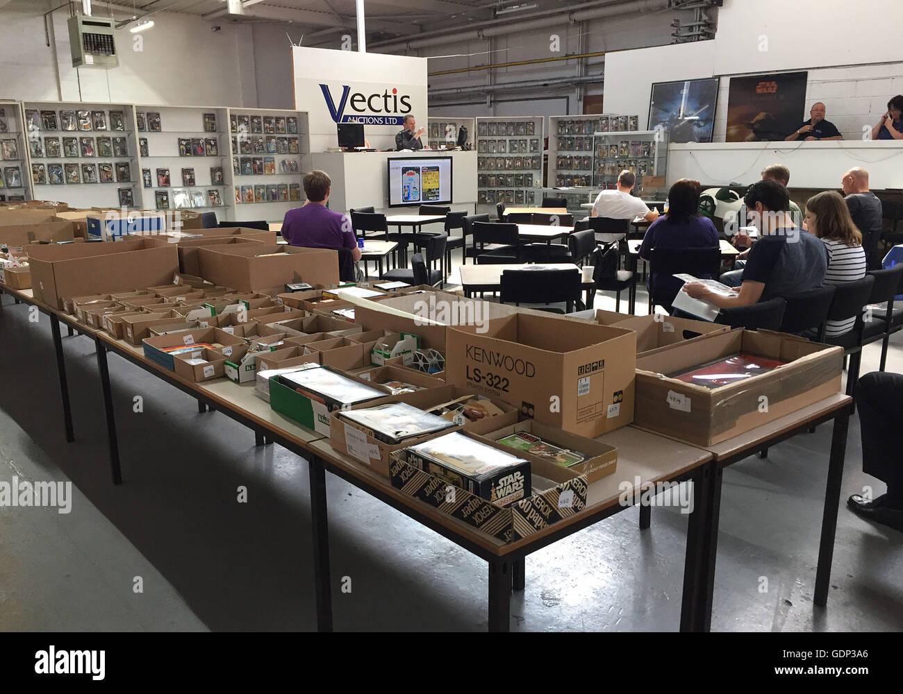 People attend the auction of a large private collection of 700 Star Wars items which are expected to bring in around £500,000 when they go under the hammer at Vectis Auctions in Thornaby, Teesside. Stock Photo