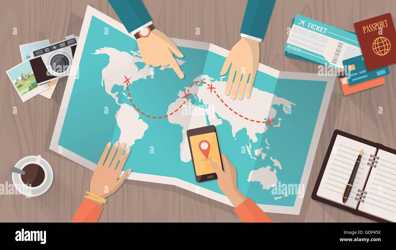 People planning a trip around the world they are pointing on a map people planning a trip around the world they are pointing on a map and using an app on a mobile phone travel and vacations con gumiabroncs Choice Image