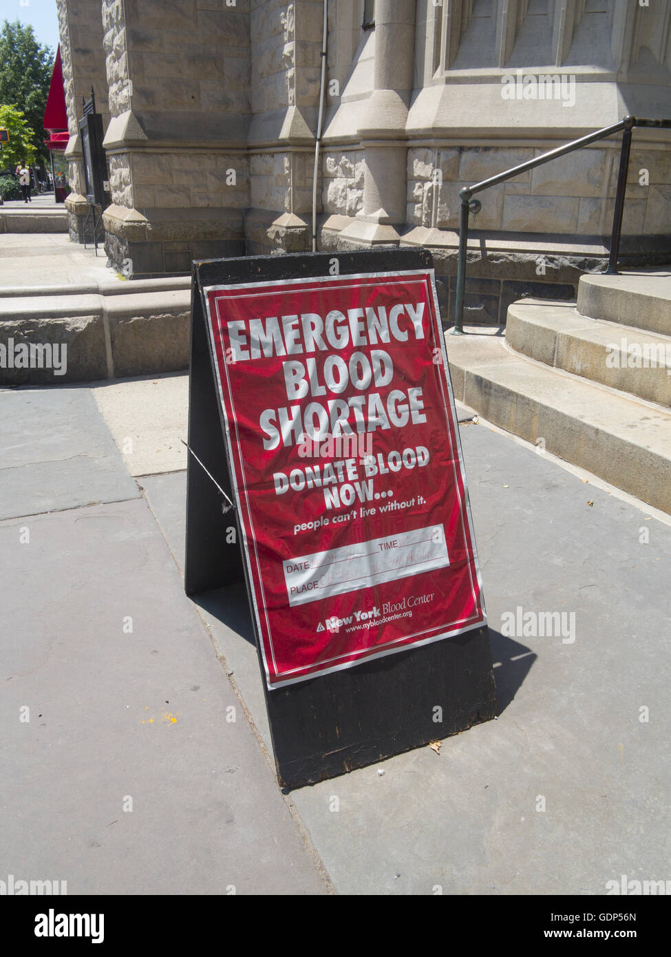 Sign to give blood in front of a church in Park Slope, Brooklyn, NY. - Stock Image