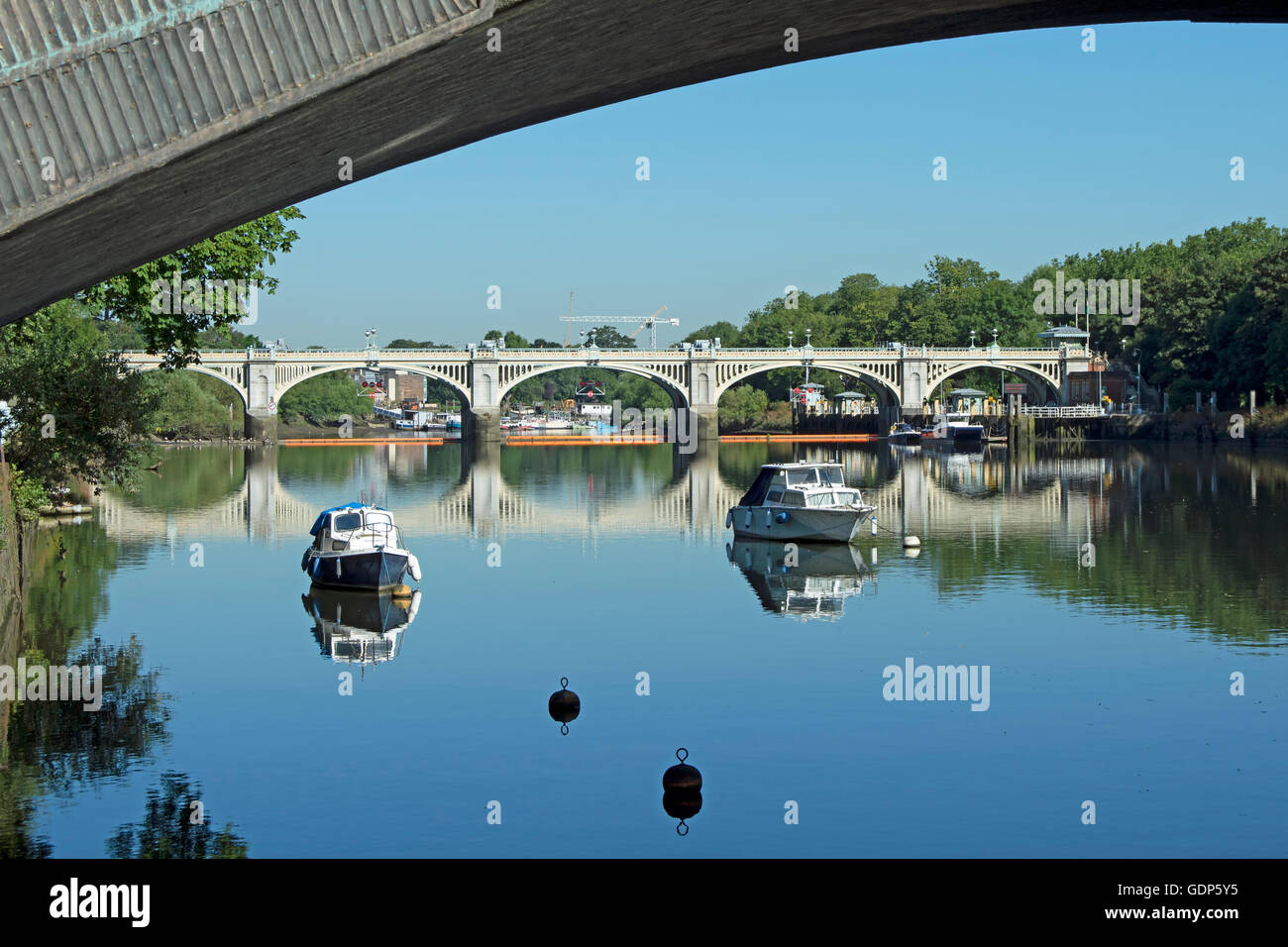 river thames seen from st magarets looking towards richmond lock beneath an arch of twickenham bridge Stock Photo
