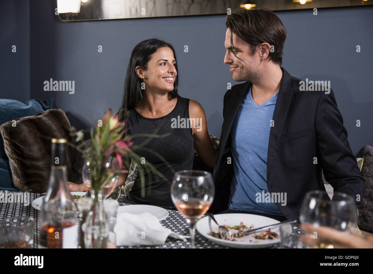 Couple on date dining in restaurant - Stock Image
