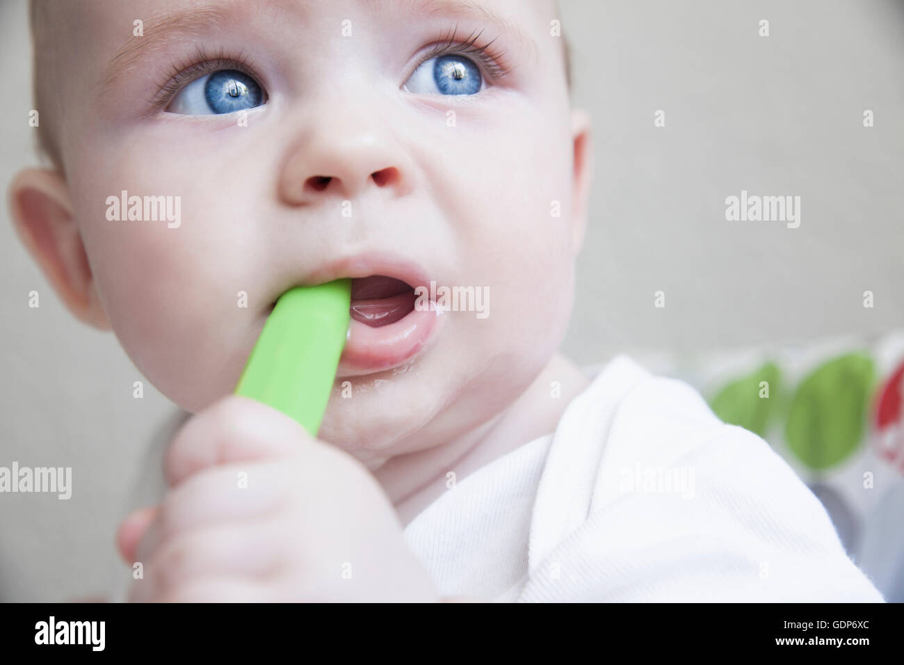 Close up of baby boy chewing teething toy - Stock Image