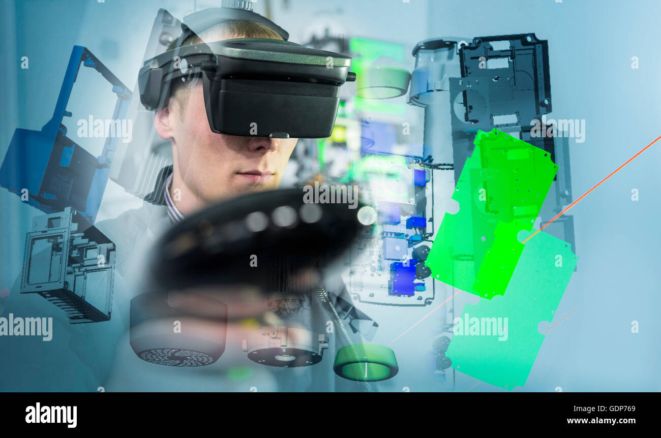 Composite image of engineer wearing VR headset in virtual reality suite Stock Photo