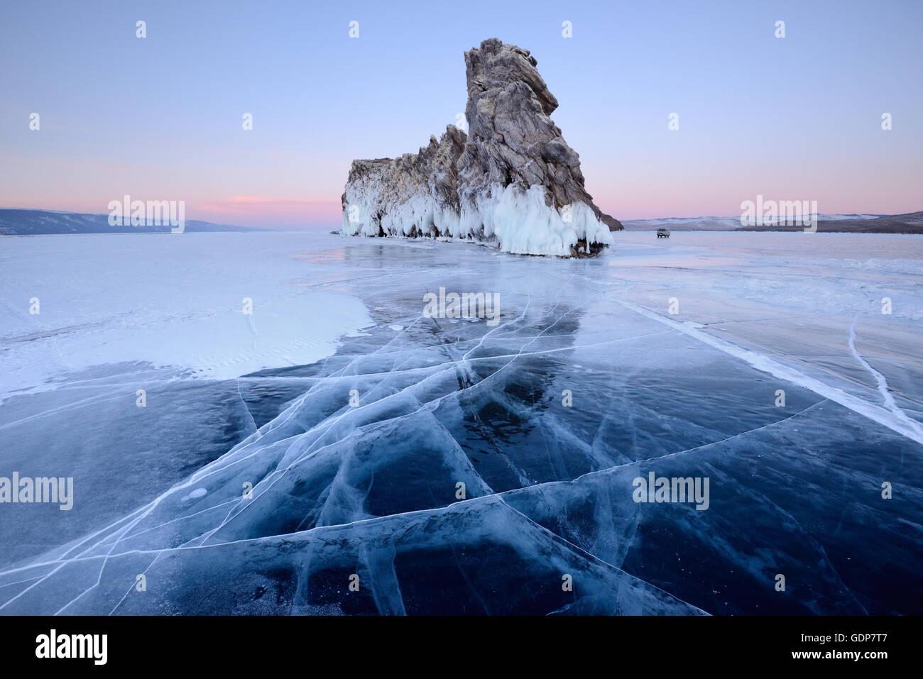 Ice and Ogoy Island, Baikal Lake, Olkhon Island, Siberia, Russia - Stock Image