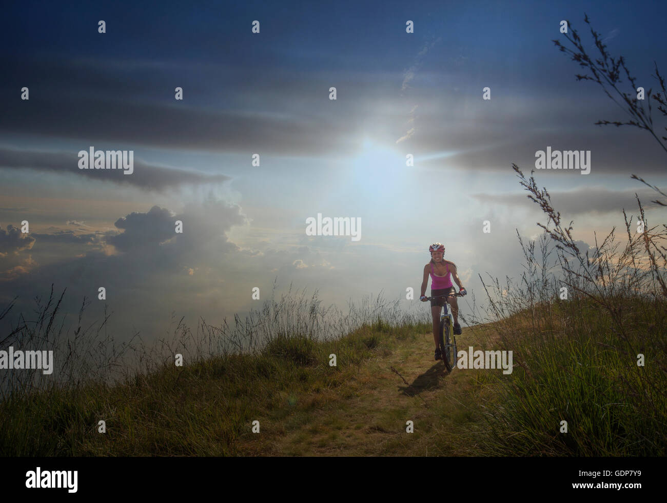 Woman with mountain bike, Canton Wallis, Switzerland - Stock Image