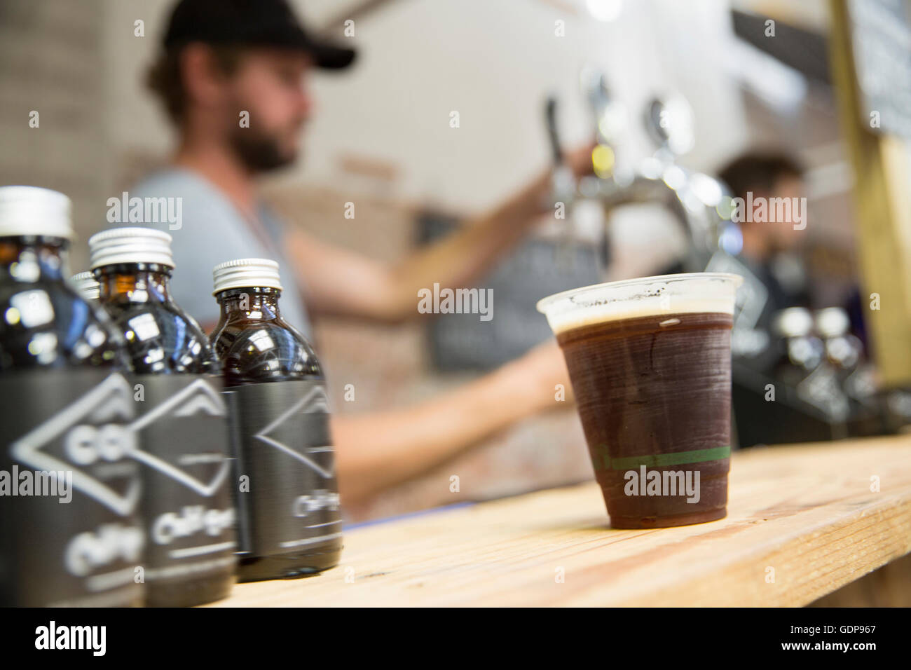 Cold brew coffee on cooperative food market stall - Stock Image