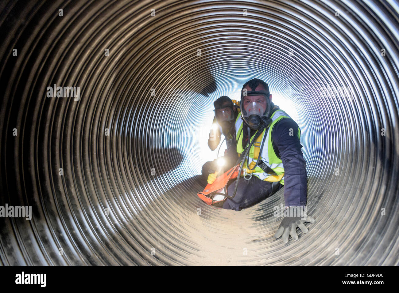 Apprentice builders training in confined space in training facility - Stock Image