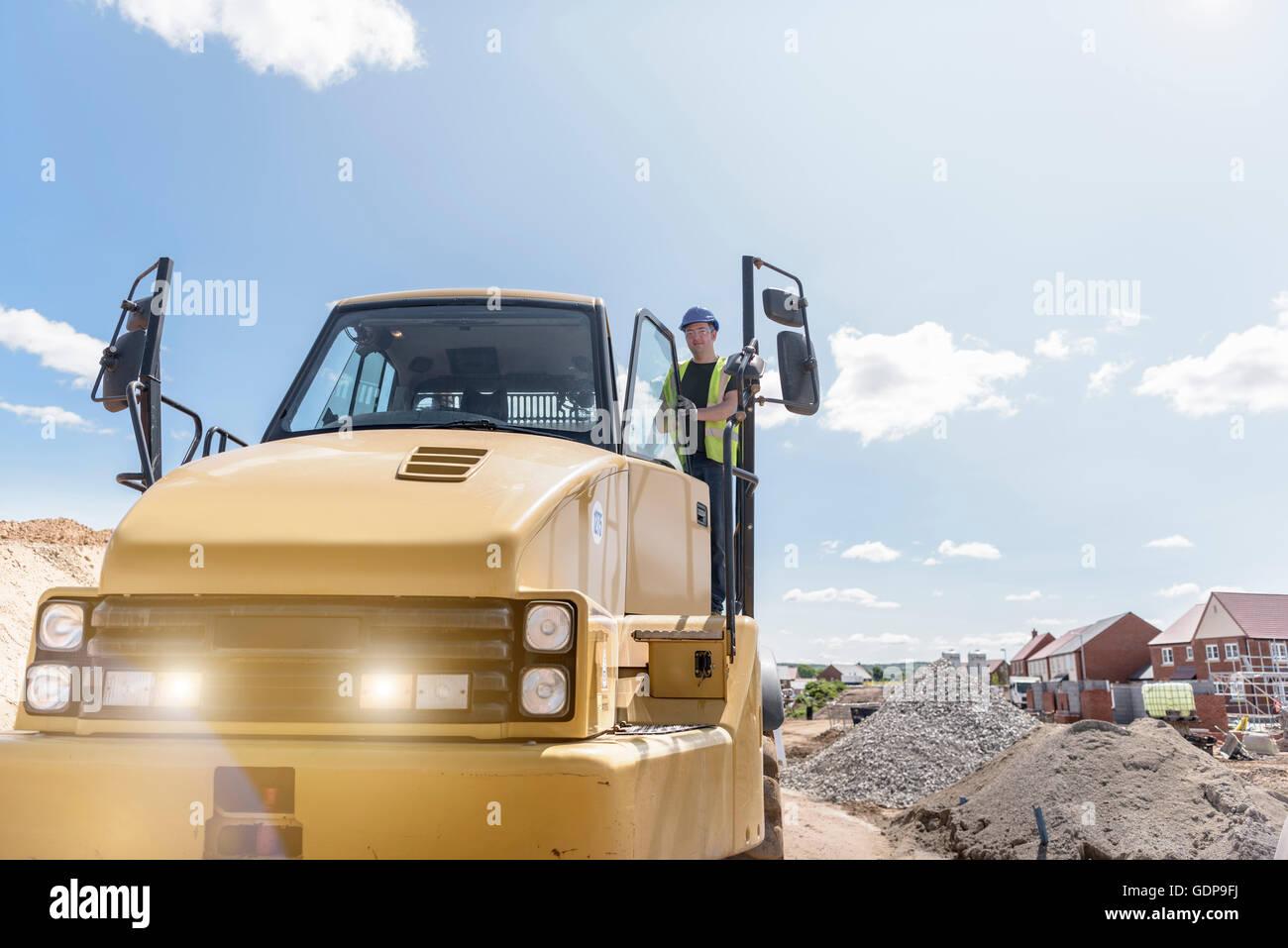 Dumper driver on housing building site Stock Photo