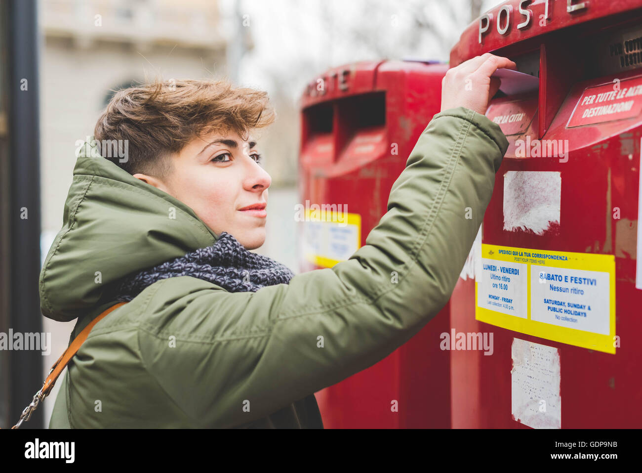 Young woman posting letter - Stock Image