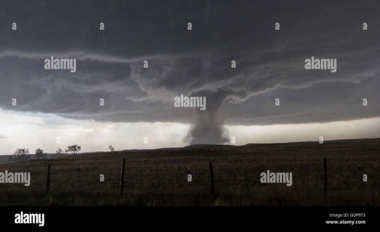 A multivortex tornado rotates over the open plains - Stock Image