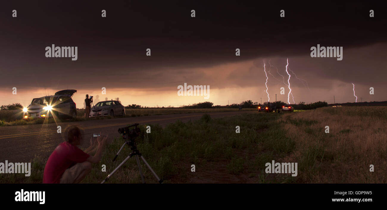 Storm chaser tracking tornadic thunderstorm in the Texas Panhandle - Stock Image