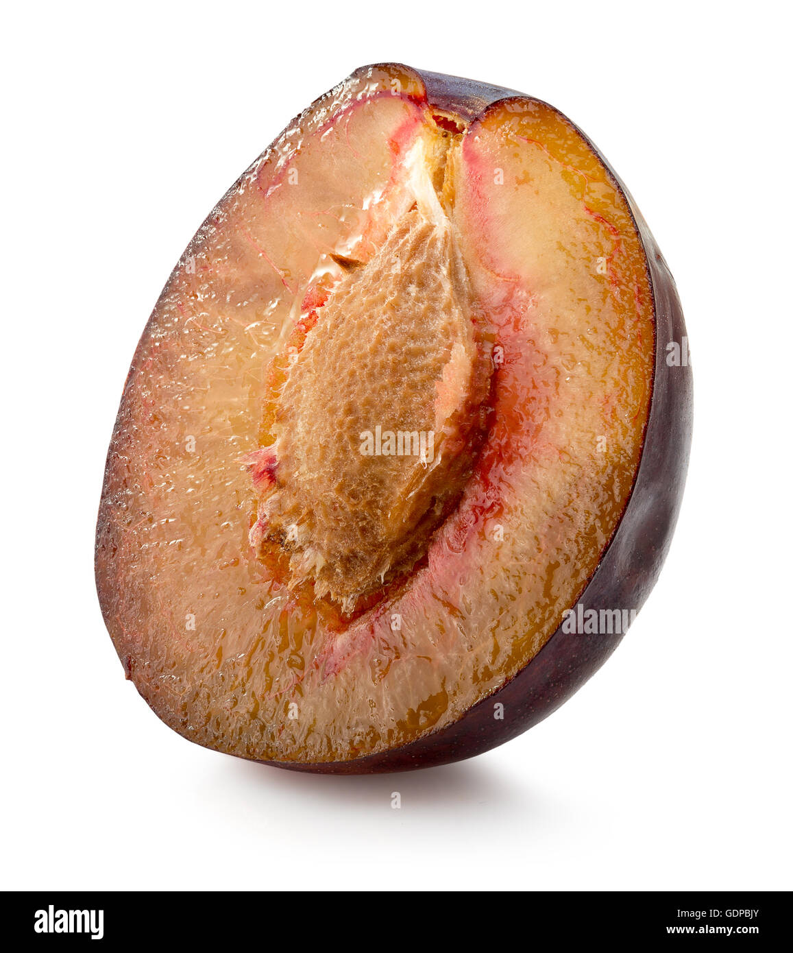 half of plum isolated on the white background. - Stock Image